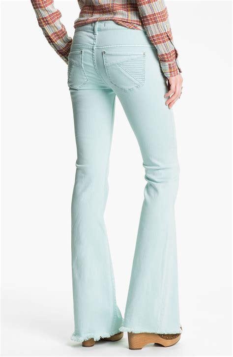light colored jeans lyst free people millennium colored denim bootcut jeans