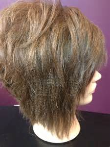 diagonal forward haircut textured flat iron style and stacked diagonal forward