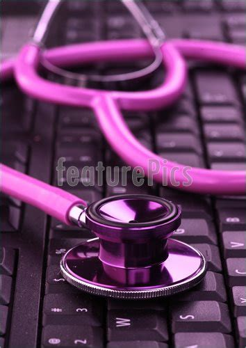 medical supplies pink stethoscope  keyboard stock image   featurepics