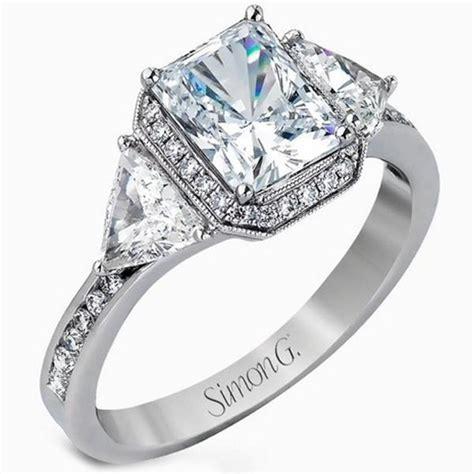 Simon G. Halo Emerald Cut Diamond Three Stone Trillion