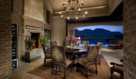 world brick dining room and fireplace mediterranean
