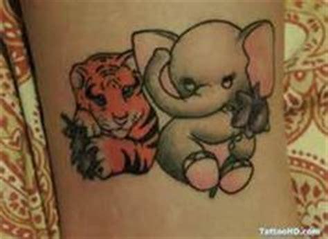 elephant ribbon tattoo 1000 images about tattoos on pinterest elephant tattoos