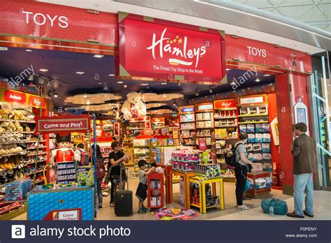 Hamleys Gift Card - passengers travellers hamleys toy shop at departures terminal at stock photo royalty