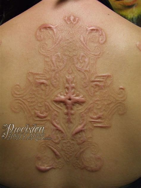 cut out tattoo designs scarification i m mildly intrigued by this yet there s