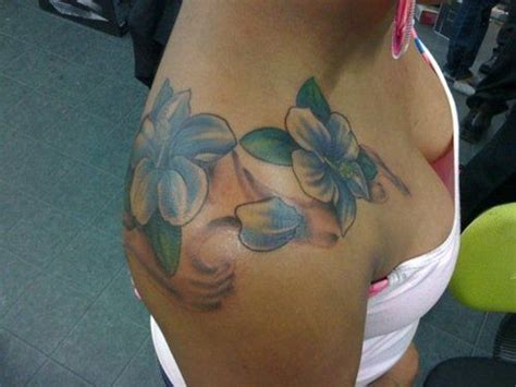 over the shoulder tattoos hibiscus shoulder placement maybe not so much