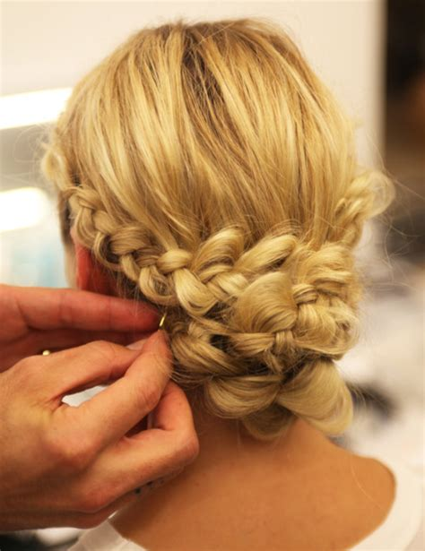 preview hairstyles on yourself from the catwalk a plaited chignon you can do yourself