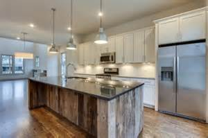 reclaimed wood kitchen islands reclaimed wood was used for the expansive island in this