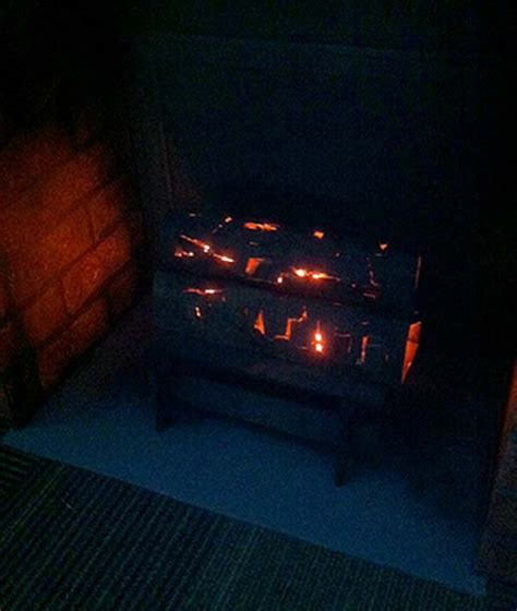 How To Light Your Fireplace by Awesome Office Worker Creates Fireplace Out Of Cardboard Boxes