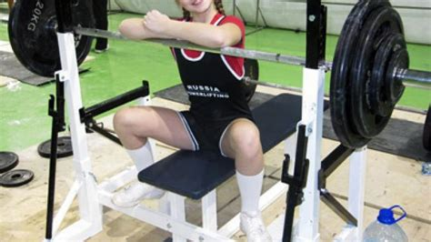 guinness world record for bench press girl raises bar on guinness powerlifting record rt sport