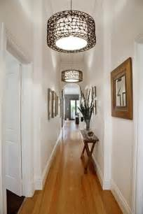 small hallway lighting ideas narrow hall table matching frames and repeating light