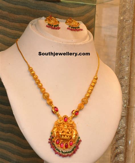 south hill design necklaces gold necklace with lakshmi pendant photo necklace