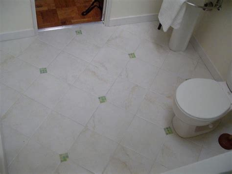 crisp clean white bathroom tiled floor with decorative