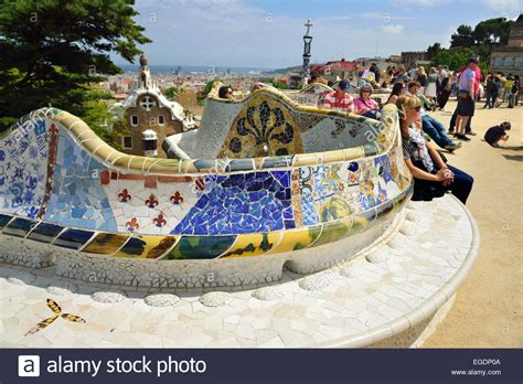 park guell bench people sitting on mosaic serpent bench park guell