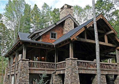 mountain vacation home plans wrap around outdoor living area 18709ck craftsman
