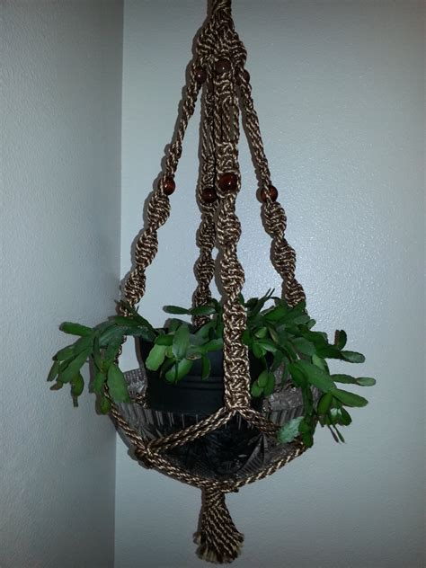 macrame plant hanger handmade by seewhatshanginaround on etsy