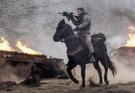 12 strong the declassified true story of the soldiers books 12 strong trailer chris hemsworth leads soldiers in