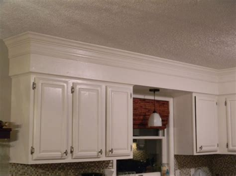 hide soffit above kitchen cabinets by adding crown molding ideas to cover kitchen soffit kitchen soffit molding