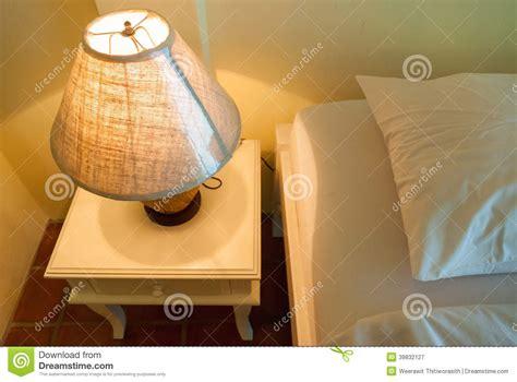 table next to bed l on a night table next to a bed stock photo image