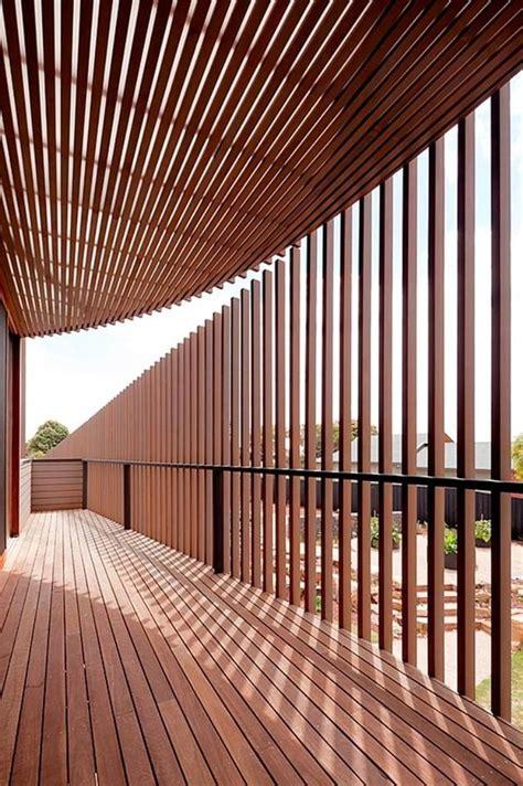 rectangular wooden property with slatted circular facade