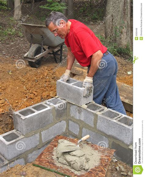Single Level Home Plans man laying concrete block wall stock photo image 6593448