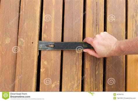 removing  wooden boards  pry bar stock photo