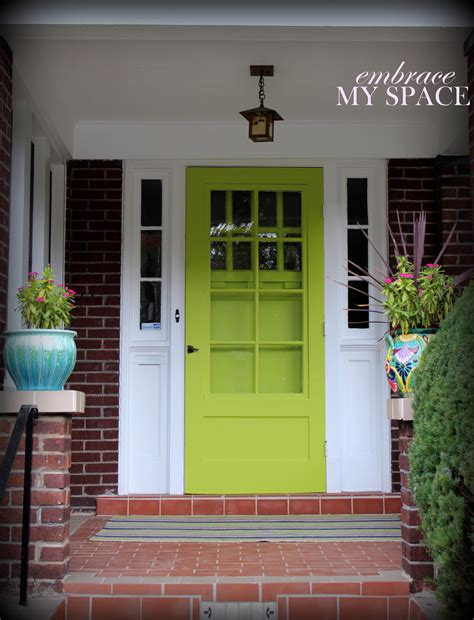 Green Upvc Front Doors Coloured Doors Coloured Doors With Milk Bottles Awaiting Collection Stock Photo