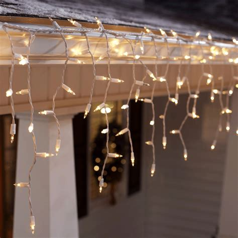 hanging christmas lights on gutters christmas light gutter clips lowes christmas decorating