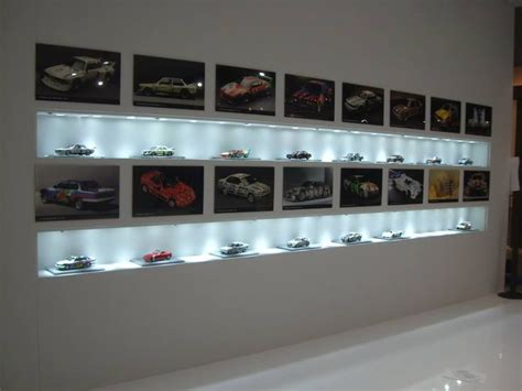 diecast car display cabinet diecast models displayed with pictures of the actual car