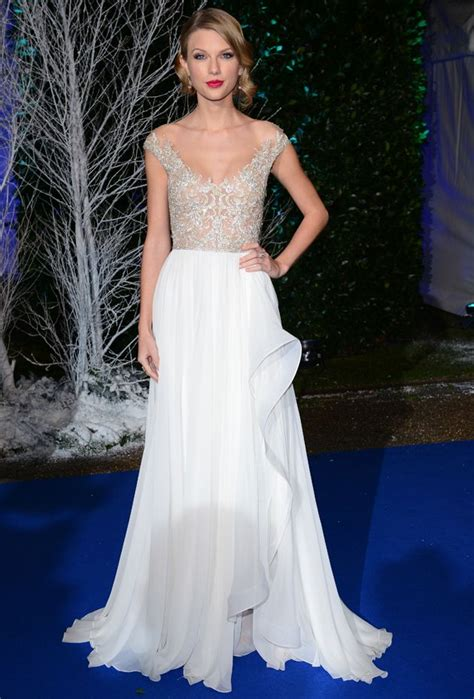 taylor swift white dress at wedding taylor swift evangeline lilly and lupita nyong o in