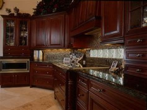 cherry kitchen cabinets with granite countertops yellow