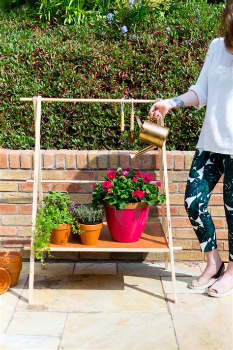 Diy Garden Shelf by Diy Ladder Plant Stand For A Compact Garden Fall