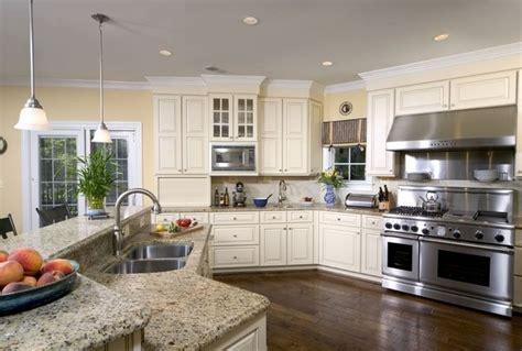off white kitchen cabinets with stainless steel appliances santa cecilia light granite countertops white kitchen