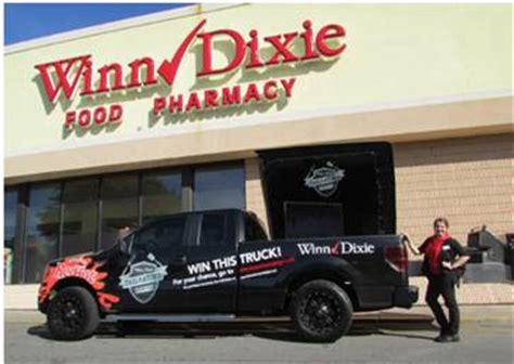 Winn Dixie Sweepstakes - winner drives away in winn dixie franks redhot tailgate truck