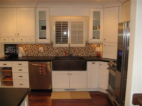 black kitchen cabinets with white countertops kitchens with white cabinets and black countertops