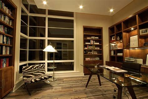 modern style study room with recessed wooden bookshelves