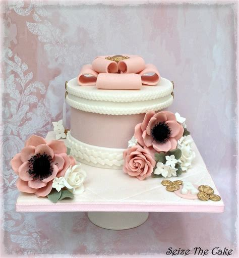 wedding cake drapes white drapes and red sugar flowers wedding cake
