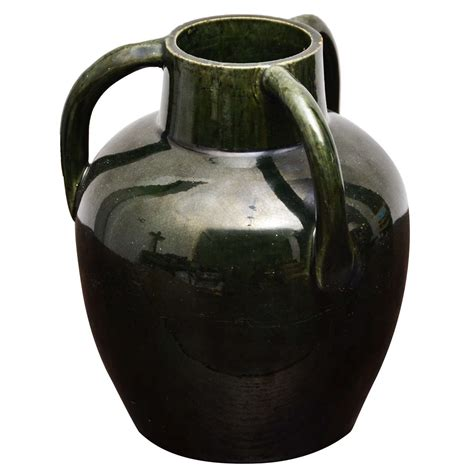 green ceramic vase with three handles for sale at 1stdibs