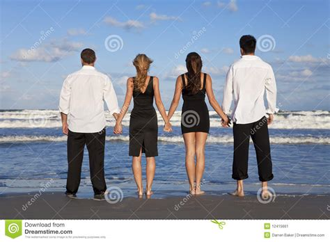 Two Couples Two Couples Holding On A Stock Image Image