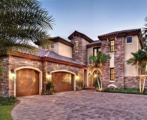 southern custom homes terracotta barrel roof tiles and stone accents enhance