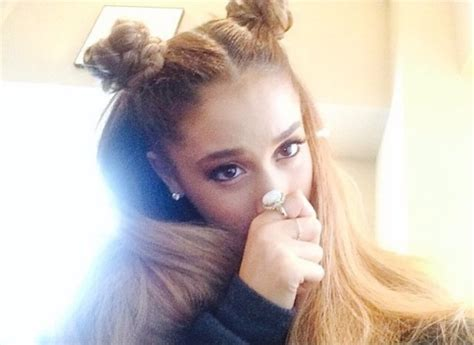 Ariana Grande switches her trademark hairstyle for braided
