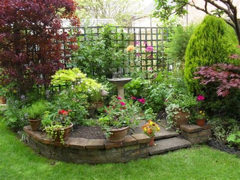 fabulous potted plants with raised flower bed for small garden design with decorative bird bath