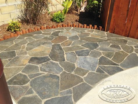 flagstone patio in the backyard tropical patio orange county by tru landscape services