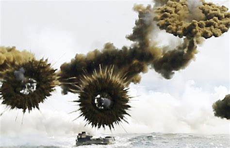 south korean marine amphibious assault vehicles fire smoke shells  land   seashore