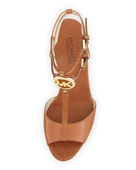 michael kors sandals wedges lyst michael kors keely logo wedge sandal in brown
