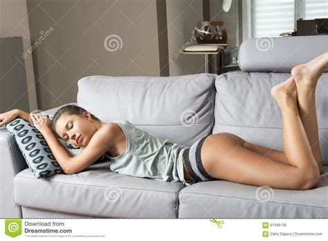 hot in sofa sensual woman sleeping on sofa stock photo image of