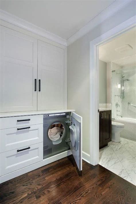 laundry design group hidden washer and dryer transitional laundry room 2