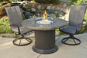 round patio dining table with fire pit search