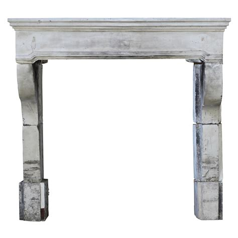 17th century antique fireplace mantel in limestone for