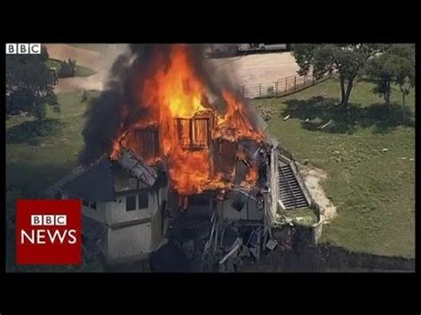 houses falling off cliffs texas house falling off cliff is set on fire bbc news youtube