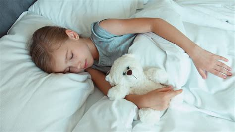 Clip On Bedroom Ls by Sleeping Child With Teddy Resting In